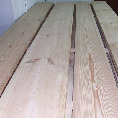 Pine floor boards cut from old beams 3